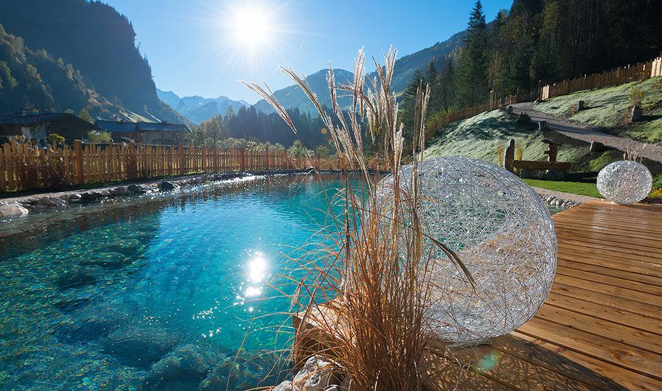 Genießen Sie Ihren Luxus Hüttenurlaub in Österreich mit Erholungsteich